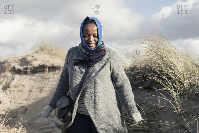 Woman from South Africa walking in dunes, Bloemendaal aan Zee, Noord-Holland, The Netherlands