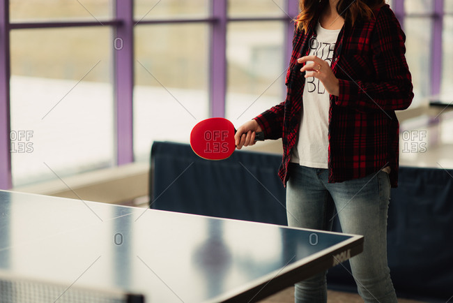 Woman playing ping pong