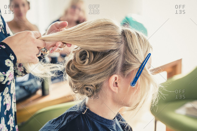Woman getting hair done for wedding