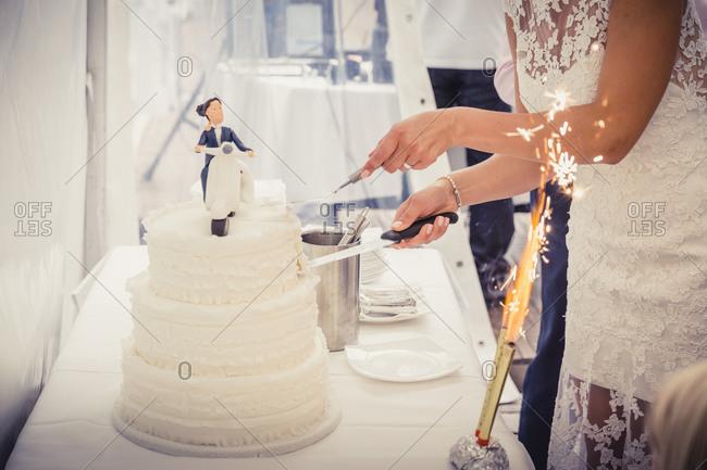 Bridal couple cutting a cake