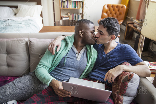 Couple kissing on the couch
