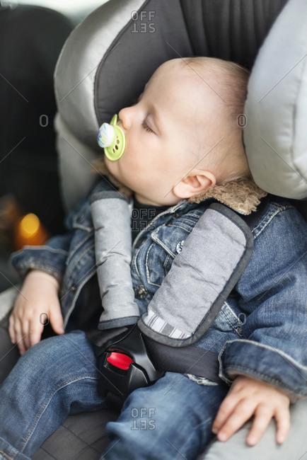 Baby boy sleeping in car seat