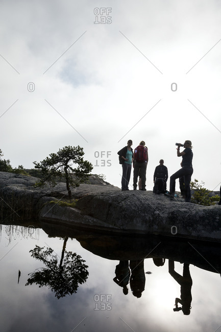 Group of hikers by lake