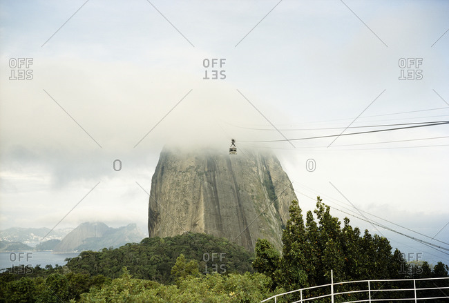 Overhead cable car leading to mountain peak