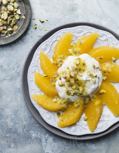 Orange and whipped cream on plate