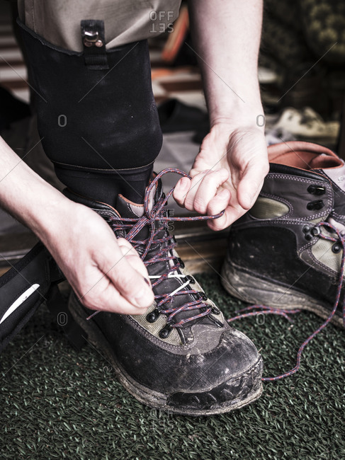 Man tying hiking shoes