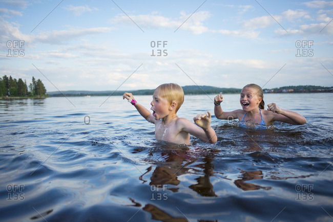 Girl and boy in lake