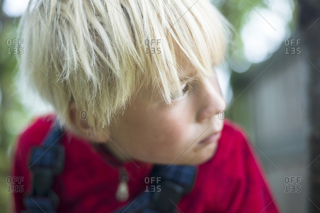 Close-up of young blond boy
