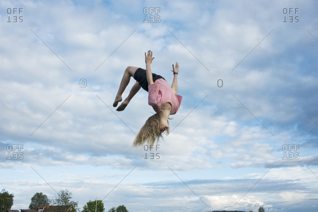Girl doing somersault mid-air