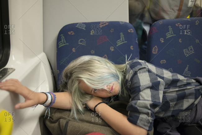 Young woman napping in train