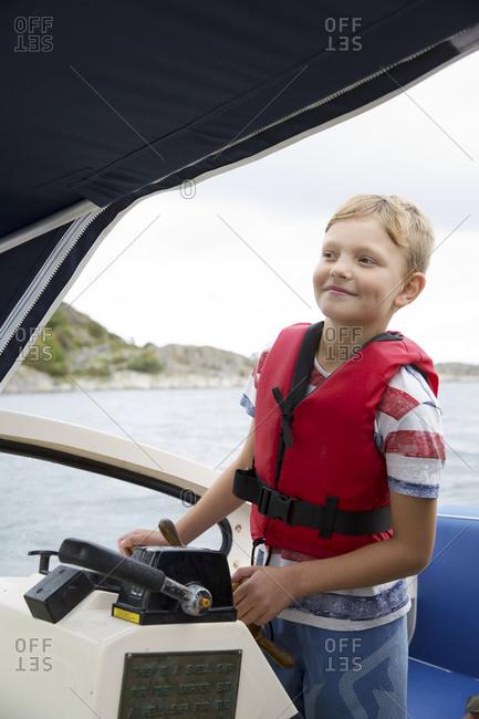 Boy driving motor boat