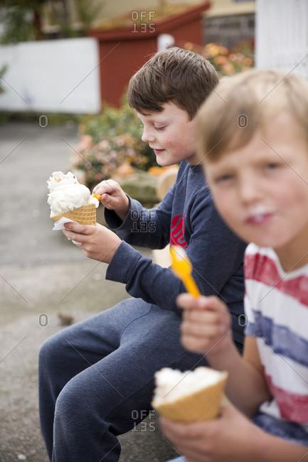 Two boys eating ice-cream