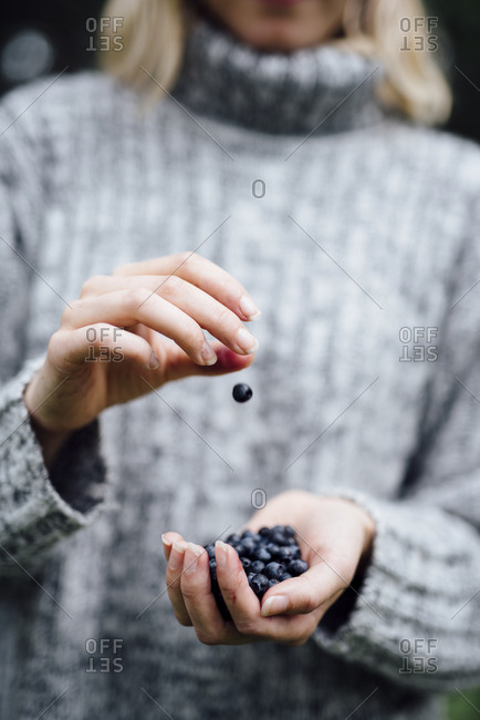 A woman holding blueberries