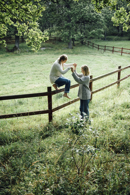 Two women at a fence