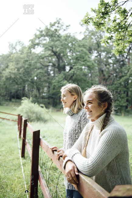 Portrait of two women at a fence