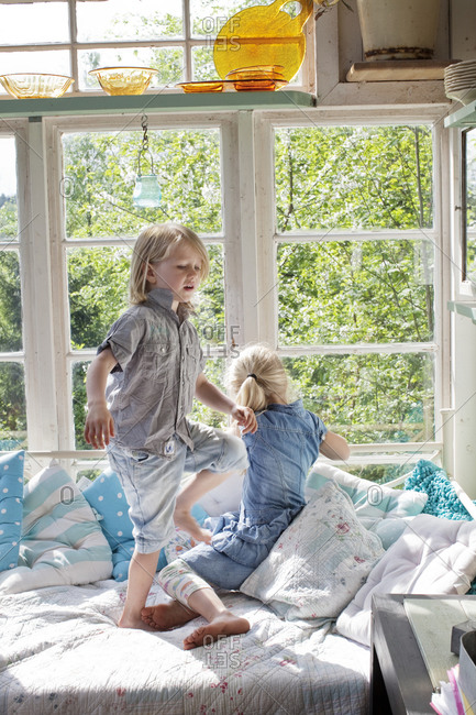Two girls playing in bedroom