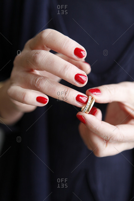 Woman putting on a ring