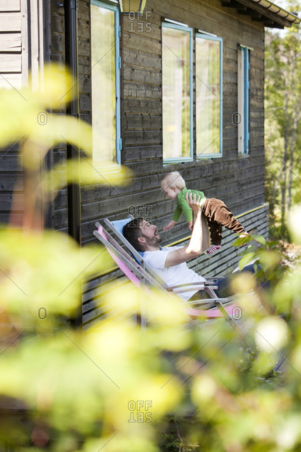 Father and child in a sun chair