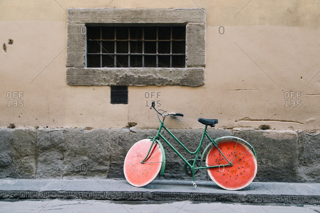 Bicycle with wheels designed to look like watermelon slices