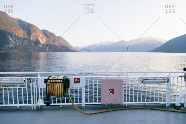 Hose unspooled along the deck of a boat