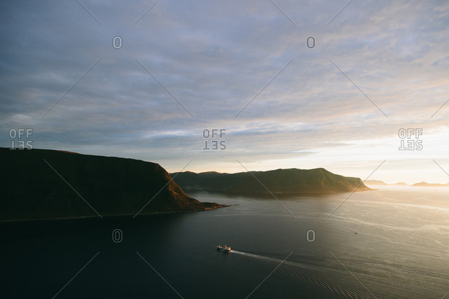 Boat sailing along a fjord in Norway