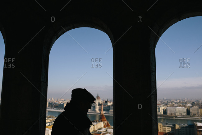 Silhouette of a man watching the Hungarian Parliament Building from the Fisherman's Bastion in Budapest, Hungary