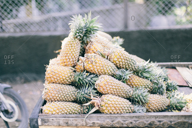 Pineapple on a wood cart