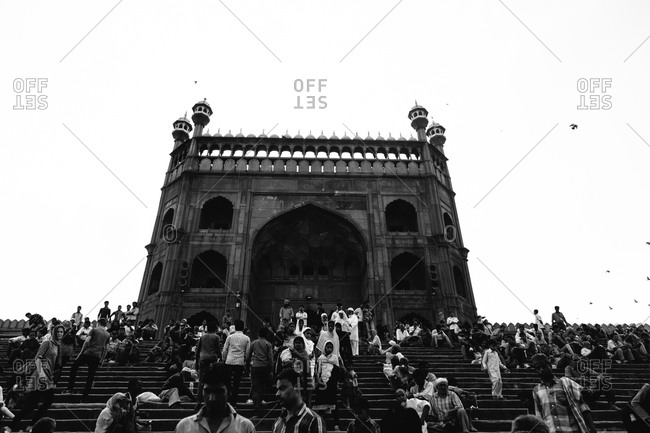 Delhi, India - April 6, 2015: Crowd gathered on the steps of the Jama Masjid Mosque in Old Delhi, India
