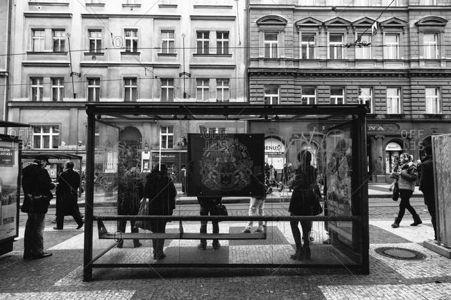 Prague, Czechoslovakia - December 16, 2014: People standing at a tram stop in Prague, Czechoslovakia