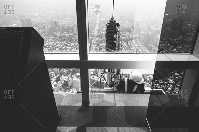 Workman in a gurney outside the Taipei 101 skyscraper in Taipei, Taiwan