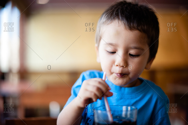 Young boy drinking from a straw
