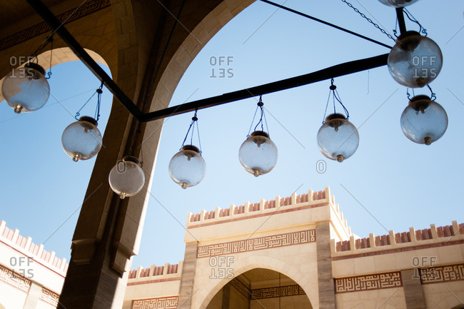 Lamps along an interior archway of the Al Fateh Grand Mosque in Bahrain