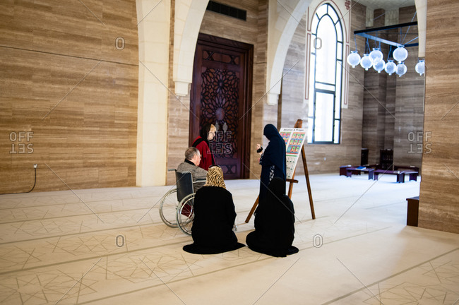Bahrain - March 8, 2010: Group of people inside the Al Fateh Grand Mosque in Bahrain