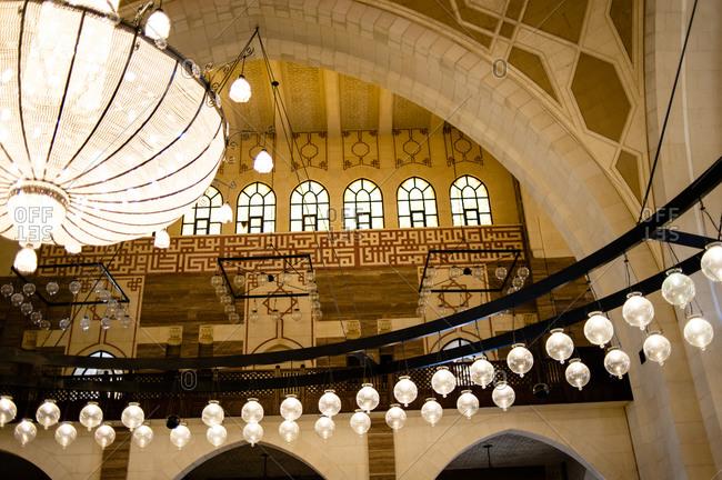 Bahrain - March 8, 2010: Lamps inside the Al Fateh Grand Mosque in Bahrain