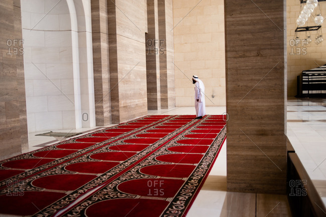 Bahrain - March 8, 2010: Man worshiping at the Al Fateh Grand Mosque in Bahrain