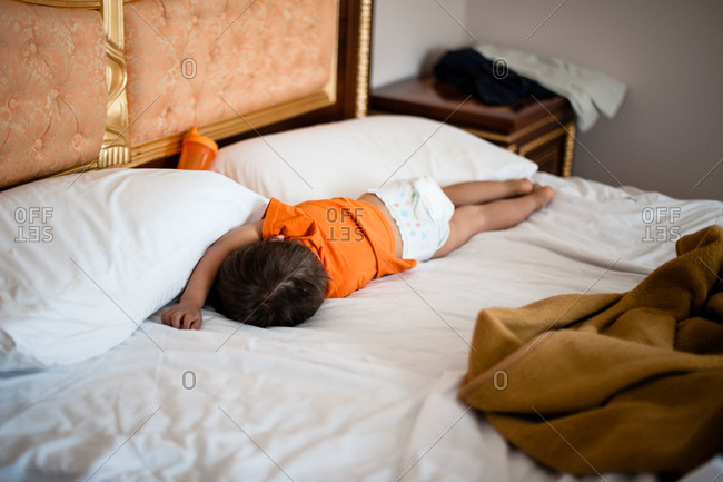 Young boy lying on his side in bed