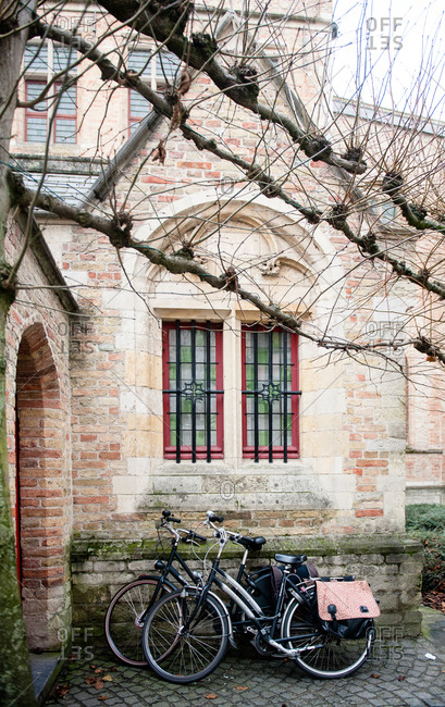 Two bicycles leaning against a building in Bruges, Belgium