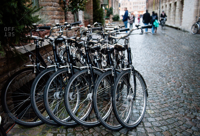 Parked bicycles along the street in Bruges, Belgium