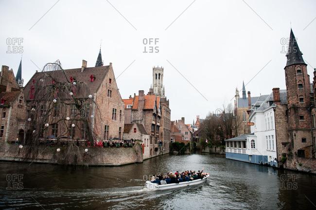 Bruges, Belgium - December 21, 2015: Bruges Canal boat tour in Bruges, Belgium