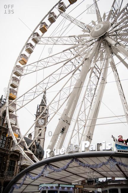 Ghent, Belgium - December 22, 2015: Roue de Paris ferris wheel in the old city center in Ghent, Belgium