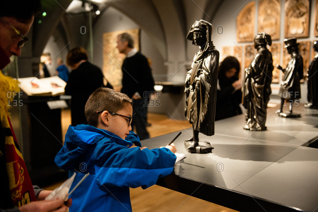 Amsterdam, Netherlands - December 25, 2015: Boy in the Rijksmuseum in Amsterdam, Netherlands
