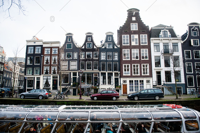 Amsterdam, Netherlands - December 26, 2015: Boat tour of the canal houses in Amsterdam, Netherlands