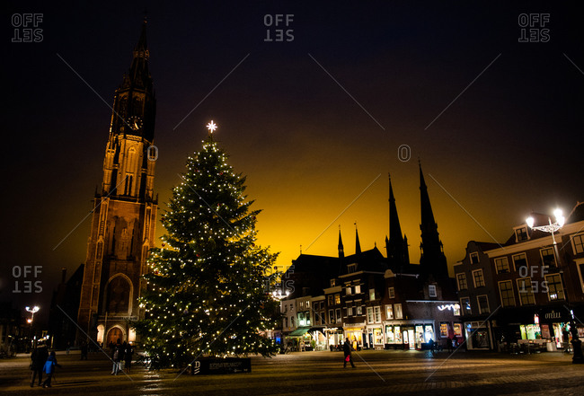 A Christmas tree at night in Market Square in Delft, Holland