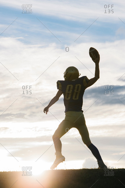 Young American soccer player about to throw ball