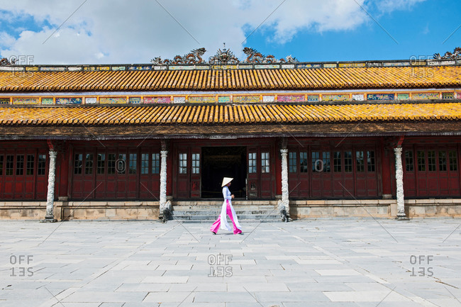 Woman walking in the old imperial city in Hue, Vietnam