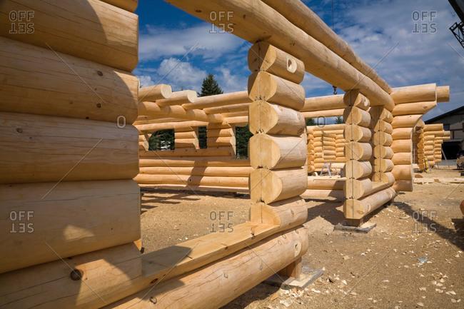 Unfinished Scandinavian Eastern white pine log cabin erected on builder's lot
