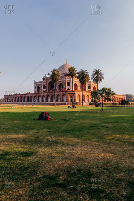 Picnickers in field at Humayun's Tomb in Delhi, India