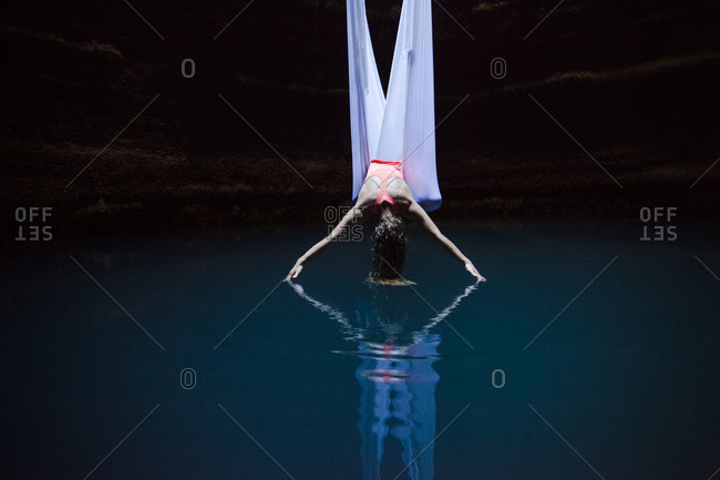 Woman dangling over water