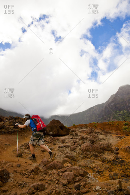 Man walking rural Hawaiian trail