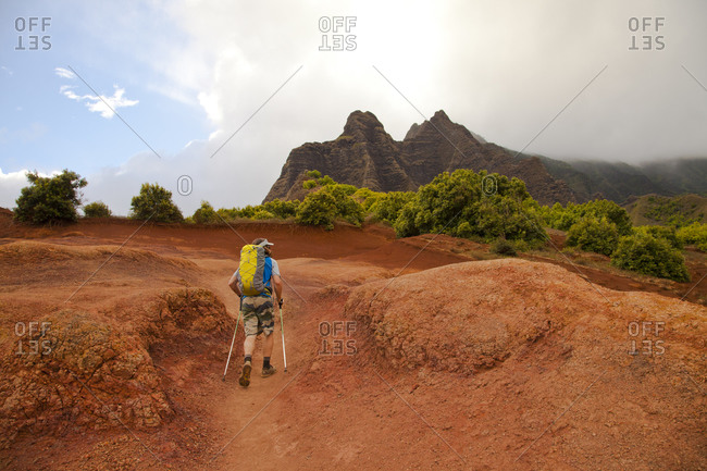 Man hiking rural Hawaiian trail